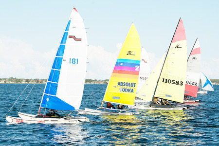 Lake Macquarie, Australia - April 18. 2013: Children competing in the Australian Combined High School Sailing Championships. Young contestants raced in various types of dinghies.
