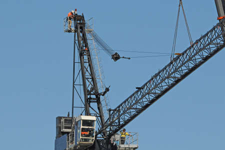 Gosford, New South Wales, Australia - May 11, 2019: High rise building under construction. Assembly of the Sky Crane day four.