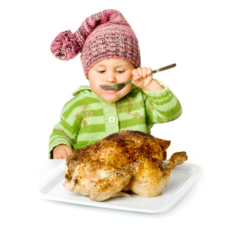 Funny child eating tasty turkey, isolated over white