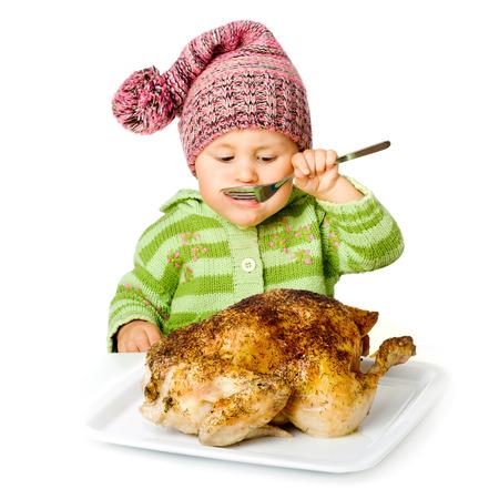 Funny child eating tasty turkey, isolated over white