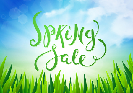 spring sale: Spring sale over wooden background with fresh green leaves
