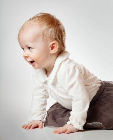 shoeless: Cute little baby girl over gray background