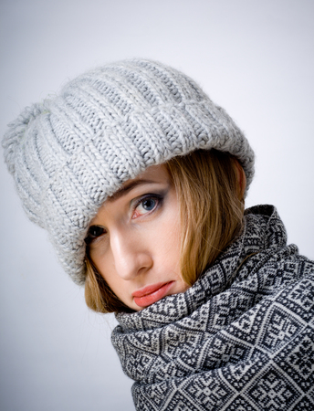 sullen: Young sullen ill woman in scarf and hat