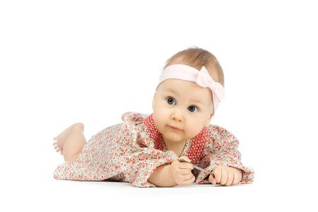 flor: Little girl lying on the flor in dress on white background