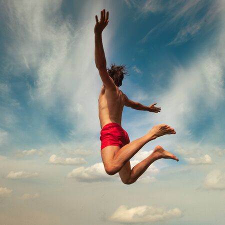 Young man jumping into water. Summer fun lifestyle