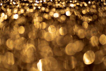 Sparkling light boke blur. Gold glitter particles background. Template for christmas theme.