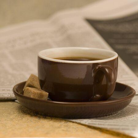 brown coffee cup and newspaper Stock Photo - 3128361