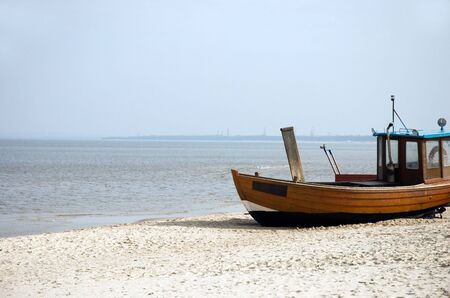 Rowing boat on the beach in northern germany Stock Photo - 3139183