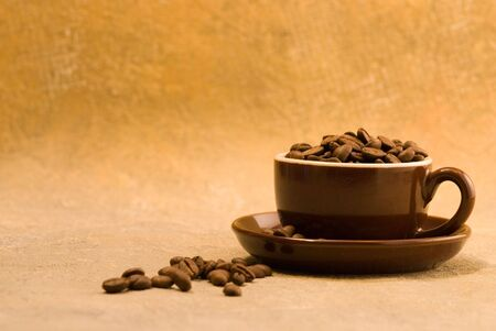 Coffeecup with coffeebeans Stock Photo - 3139128