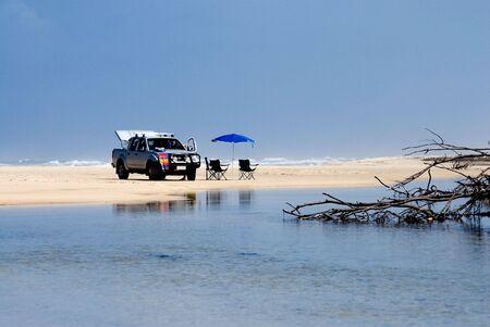 with beach chairs and umbrella on the Fraser Island BeachQueenslandAustralia Stock Photo