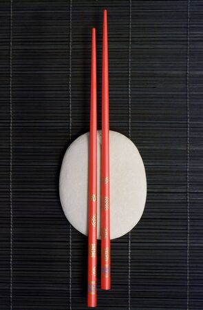 Asia still life with chopstick and pebble