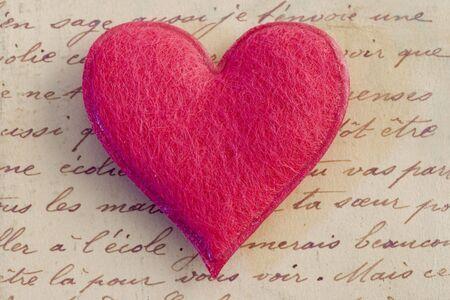 pink felt heart on handwritten letter