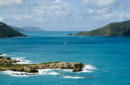 View from Camanoe Island in the BVI over the Caribbean Sea to Tortola, Guana Island and Little Camanoe Island Stock Photo