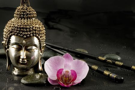Still life with buddha head, orchid and chopsticks Stock Photo
