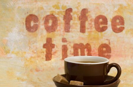 coffeetime: coffee mug and handmade background with writing, artwork in the back is created and painted by myself