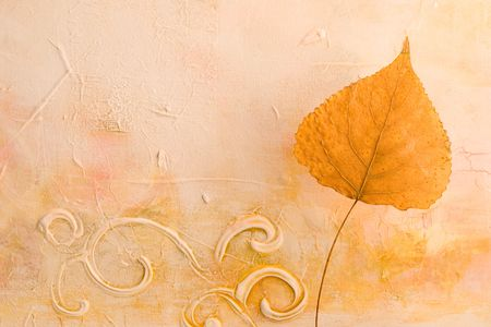 pressed leaf in front of artwork, artwork in the back is created and painted by myself Stock Photo - 3169087