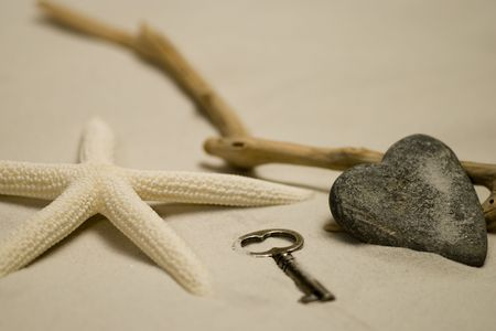heart shaped stone with starfish and driftwood photo