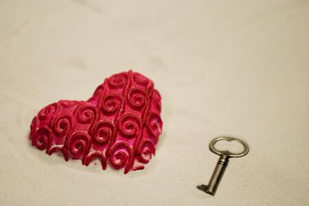heart on the sand: red heart and key in the sand