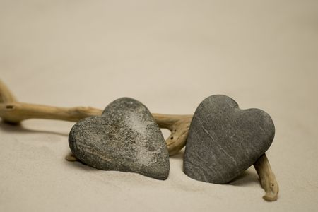 Two heart shaped stones on the beach