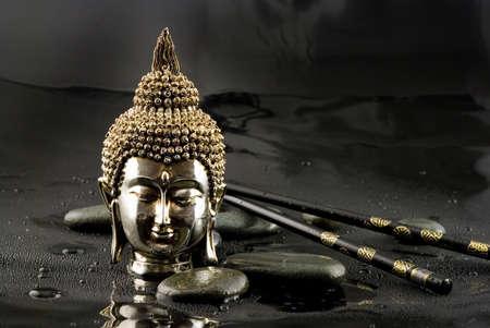 Buddha head with chopsticks