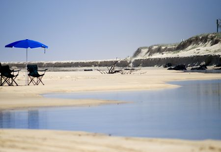 with beach chairs and umbrella on the Fraser Island Beach/Queensland/Australia Stock Photo