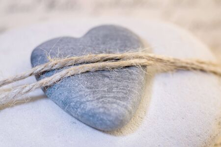 stone heart tied with rope