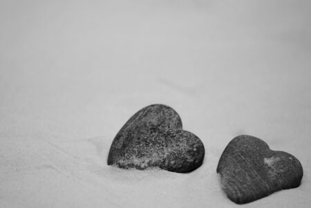 heart of stone: Two heart shaped stones on the beach