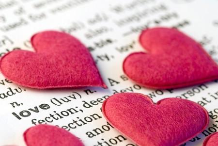 little pink felt hearts on text love Stock Photo - 4270248
