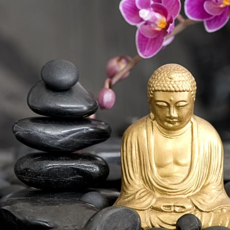 stone buddha: golden buddha statue with orchid flower and stone tower