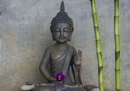 still life with buddha statue photo