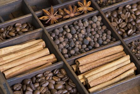 assortment of spices in a wooden box Stock Photo