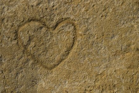 heart shape carved in sand stone photo