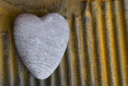 stone heart on rusty surface Stock Photo - 5569214