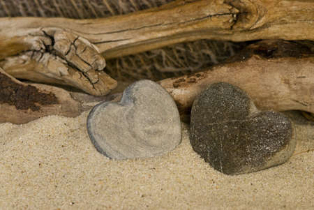 stone heart and driftwood on the beach photo