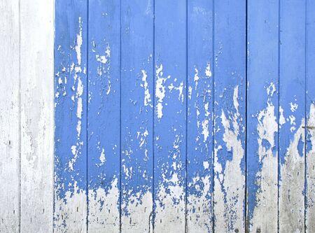 peeling paint: vecchie tavole blu con vernice scrostata