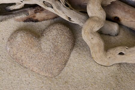 heart made of sand and driftwood Stock Photo - 5729882