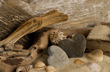 stone heart and driftwood on the beach