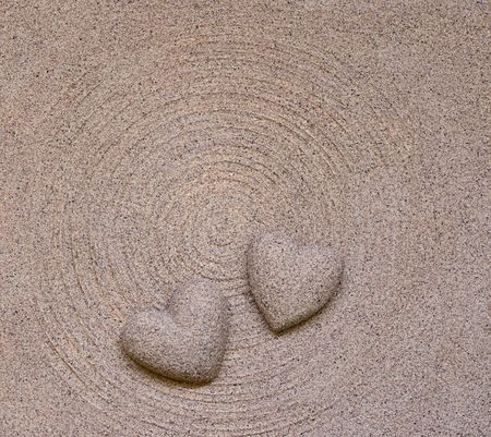 sand hearts on circle background