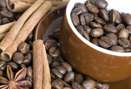 Coffee mug, cinnamon and coffee beans