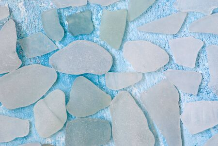 pices: white pices of sea glass on blue background