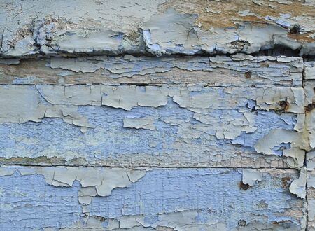 wooden plank with blue peeling paint photo