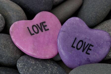 pink stone hearts with message on gray pebble Stock Photo