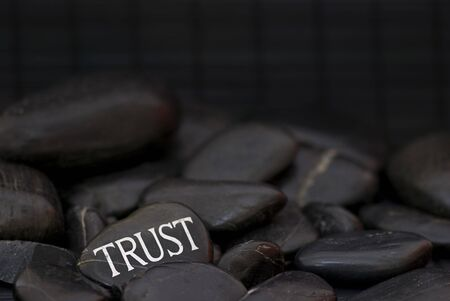 black pebble with engraved message trust Stock Photo - 6384255