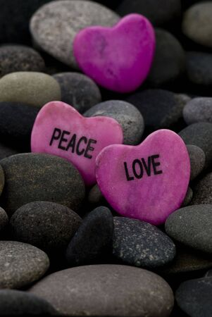 pink stone hearts  with message on gray pebble photo