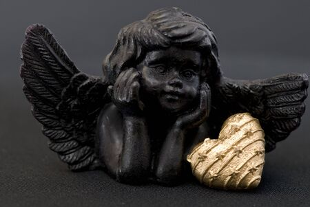 little black angel with heart Stock Photo - 6534693