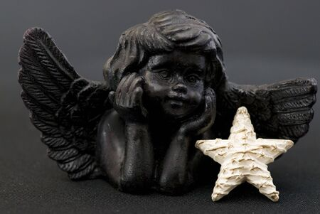 little black angel with star Stock Photo - 6534695
