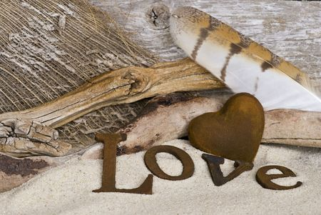 word love and heart in sand