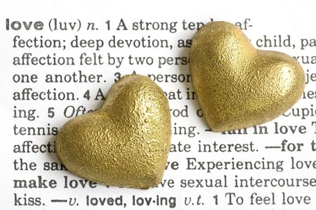 two golden hearts on dictionary love text Stock Photo - 6534718