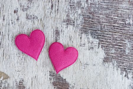 two pink hearts on old driftwood Stock Photo - 6534723