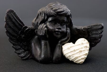 little black angel with heart Stock Photo - 6550642